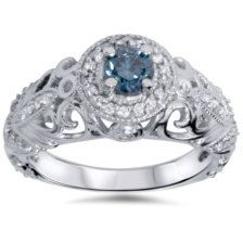 PRODUCT DETAILS  Item #ENG84681EDB.9Width:6 mmMetal: 14k White GoldDiamond Cut: Round, BrilliantDiamond Color: G/HDiamond Clarity: I1-I2Diamond Carat: 0.7Diamond Quantity: 50Diamond Setting: Prong    .70 cttw Blue & White Diamond Vintage Style Halo Engagement Ring 14K White Gold  This womens ring features a 3/8ct blue diamond color enhanced and white accent diamonds set in solid 14k white gold.