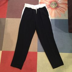 Rachel Roy Track Pants Rachel Roy black track pants with white side stripe and drawstring waist. SO comfortable and chic- easy to dress up or down. Like new! RACHEL Rachel Roy Pants Track Pants & Joggers