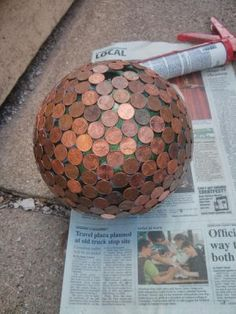 Penny Balls Tutorial:  Penny ball is made from clear silicone caulk, a bowling ball and pennies. It's easy to do, and makes a perfect gift for someone who loves to garden.