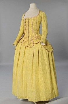 Caraco (jacket) and skirt, ca. 1785. Made of yellow Gros de Tours striped silk and trimmed with ribbon.