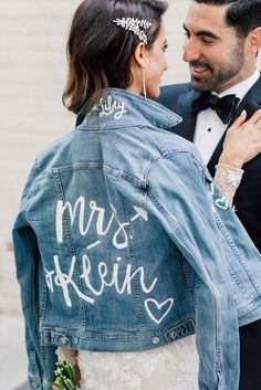 Wedding jackets are so on trend right now. Brides are loving these customized denim and leather jackets because they make the cutest lifelong keepsake (you can actually wear), and they look drool-worthy in wedding photos! If you are contemplating getting yourself a wedding jacket, then you have to check out some of our Denim Wedding, Wedding Jacket, Ballroom Wedding, Wedding Bride, Elope Wedding, Fall Wedding, Wedding Decorations On A Budget, Sustainable Wedding, Bridal Shower Welcome Sign