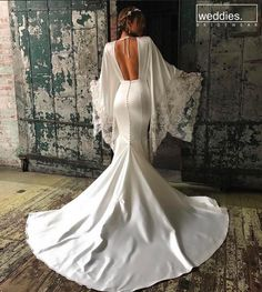 Snow angel sleeves and a sultry back! Loving this gown worn by beautiful bride Celebrity Wedding Dresses, Celebrity Weddings, Hollywood Gowns, Couture Wedding Gowns, Black Bride, Wedding Dress Sleeves, Dream Dress, Beautiful Bride, Wedding Styles
