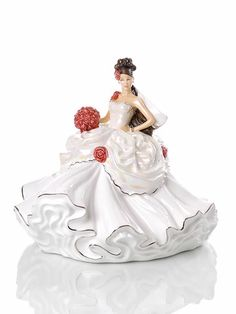 Gypsy Wedding Dreams - Gypsy Wedding Dreams #figurine is a young, romantic gypsy #bride, dressed to impress with her billowing white gown finished with large roses and carrying a matching bouquet of roses. Her dress is finished with either gold trimmings and accessories for the blonde edition or silver for the brunette version, with even the lace decoration of the bride's veil following this theme!