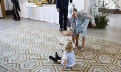Princess Madeleine seemed to be fighting a losing battle with her giggly little girl, Princess Leonore of Sweden, who was perched on a rug with a little friend. As her mom tried to distract her by pointing to something in the distance, the royal cutie looked to be holding her ground. Photo: © Rex