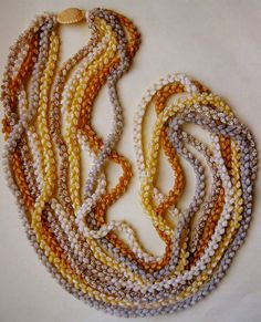 NIʻIHAU SHELL LEI - Momi pikake 5-strand lei, each in a different color.  Some of the strands are incredibly rare shells.| Rachael Ray Art Collection