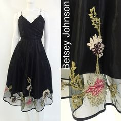 Betsey Johnson Midi Fit and Flare Dress Vintage inspired midi fit flare dress by Betsey Johnson. Adjustable spaghetti straps, wrap V bodice, lined, sheer top layer, crocheted floral detail at bottom of skirt. Worn only once, like new condition! Size ( 10 ) Bust ( 33' ) Waist ( 28' ) Hips ( 44' ) Length ( 44' ) Material ( 100% polyester ) Betsey Johnson Dresses Midi
