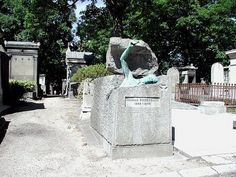 Bronzed statue breaking out of tomb