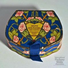 Racarma - Reine des Fleurs                     Specialty:Face Powder Boxes                    Type:powder                    Material(s):cardboard                    Designer/Maker:Racarma                    Bottle Origin:Detriot, Michigan, USA                    Date or Era:1916 in ad