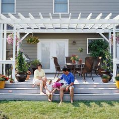 white pergola with light gray deck, steps down to yard