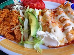CANCUN TAQUERíA - 1107 Broad St. The Lunch Buddy thoroughly enjoyed her enchiladas, which were plated beautifully. It came with Spanish rice, beans and a little avocado salad, too. And she loved that the chicken enchiladas came in white corn tortillas. Instead of being fried, the tortillas had been dipped in a sauce before being rolled up, perhaps a ranchera-type sauce.