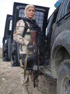 This woman from the Afghan Special Forces serves alongside her husband and Crisis Response Unit teammates during a clearance operation. Credit: ISAF Joint Command (IJC)