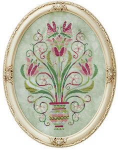 Glendon Place Dance of the Tulips - Cross Stitch Pattern. Model stitched on 32 count Valor Belfast linen using Caron Collection Waterlilies, Anchor & Mill Hill