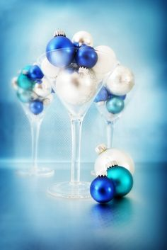 Blue and silver Christmas bulbles presented in martini glasses make a striking table decoration.