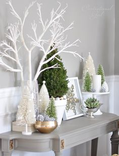 White Christmas decor via Centsational Girl Group items on cake stand - love the silver metallic table