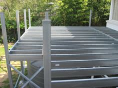 Boxspan Steel Frame Deck with posts to handrail height constructed over a water tank.