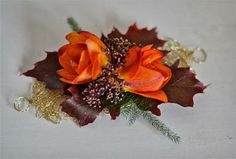 Freesia and oak corsage.  Not sure if I really like the freesia but another nice way to work in orange