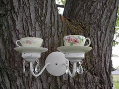 Recycled Garden Art Tea Cup and Saucer and old light fixture sconce repurposed into bird Feeder; Upcycle, Recycle, Salvage, diy, thrift, flea, repurpose!  For vintage ideas and goods shop at Estate ReSale & ReDesign, Bonita Springs, FL