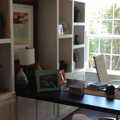 Built in office shelves and desk. I like how the desk is perpendicular. I'd like something like that but one that can fold under when not using it.