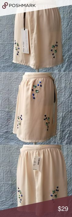 NWT Cream Skirt with Sequins/beading Stunning cream colored skirt with vibrant blue and teal sequins and gold beads. None the Richer Skirts Mini