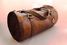 This leather duffel bag is one of my favorite creations, I can say that this is my flagship. The design took years and the implementation took months by the time this special bag was finally created. I recommend it to those who really love the striking, eye-catching, extravagant pieces.  etsy.com/shop/ SteixnerLeatherArt#carving #engraving #leatherworks #leathercrafts #leatherman #leatherwallet #leathercarving #leatherengraving #leathercraft Leather Briefcase, Leather Bags, Cow Leather, Leather Purses, Leather Wallet, Leather Engraving, Leather Carving, Duffel Bag, Tote Bag