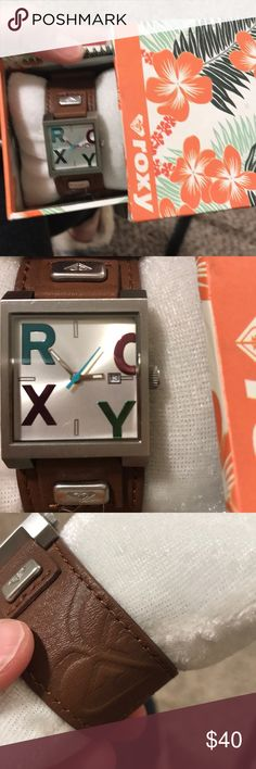 Roxy leather watch Brown leather watch band, roxy in multi colored letters and a silver face. Perfect condition no scratches in face or leather. Original box. Vintage piece. Needs battery, works perfectly. Roxy Accessories Watches