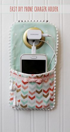 This DIY Phone Charger is so easy to sew up and makes such a cute holder for your phone while it's charging!
