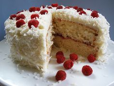 Coconut  Raspberry Cake with Cream Cheese Frosting by culinarycory