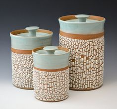 3 piece stoneware canister set with beautiful robins egg blue glaze on the interior and a white crackle glaze on the exterior. A great addition to