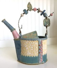 Handmade ceramic slab pottery watering can with wire and bead handle. Antique lace panel inlay rubbed with yellow underglaze. Glazes include Laguna robin's egg, Amaco Storm, Fog and Cherry Blossom celadons, Coyote Gun Metal Green over Light Shino. Hand Built Pottery, Slab Pottery, Ceramic Pottery, Pottery Art, Thrown Pottery, Ceramic Teapots, Ceramic Clay, Ceramic Vase, Handmade Pottery
