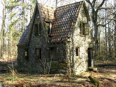 Stone house in the forrest of Denmark | Flickr - Photo Sharing!  When the Germans were in Denmark in WWII, they took over a man's farm. This man moved into the deep forest and made this house of stone. Around the house is a moat.  This place is in Jylland, behind Tirstrup airport.