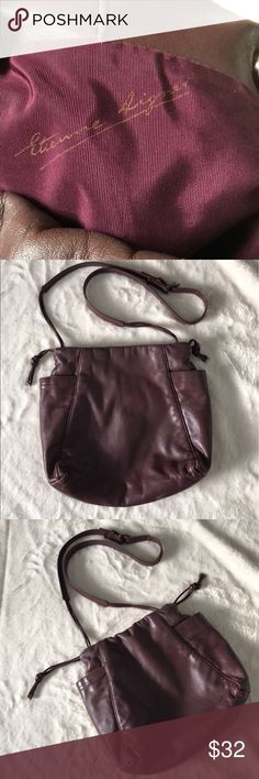 Vintage Etienne Aigner leather crossbody bag Vintage Etienne Aigner leather crossbody bag, wine color leather and interior, drawstring closure with one-magnetic  snap, zipper closure pocket, deep side pockets, minor scuffs on leather but still in great condition and has lots of life left in my opinion, Please feel free to ask questions or make an offer.      Outside measurements length 10in X width 9.5in Exterior deep pockets length 7in Etienne Aigner Bags Crossbody Bags