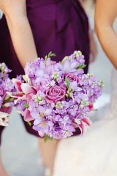 light purple wedding flowers I love the contrast of light colors to the dark dress would be cute for bridesmaids to have a dark dress with light flowers and the bride in a white dress and darker flowers @Sheena Birt (Nina) Harvey