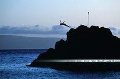 A cliff diver, divin