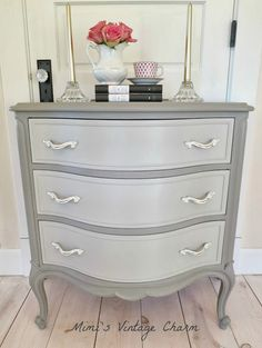 Annie Sloan Chalk Paint -- French Linen with a mix of French Linen and Old White on the drawers. Clear wax with some dark wax in details.