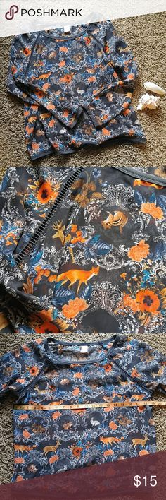 Bongo Forest Animal Print Blouse Great condition, super cute forest animal print. It has foxes, deer, rabbits and squirrels. Very unique top. See photos for measurements and tag info.  Send a reasonable offer or bundle and save 15% on my closet! BONGO Tops Blouses