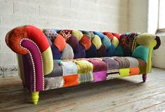 Modern British and handmade Walton Patchwork Chesterfield Sofa. Totally unique fabric 3 seater, shown in vibrant forrest multicoloured fabrics. | Abode Sofas