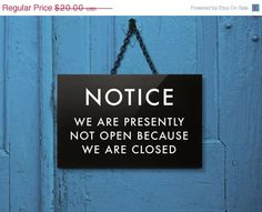 Notice: We are presently not open because we are closed. Stating the obvious sign