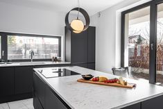 Minimalist modern kitchen with island configuration. #islandkitchen #islandkitchendesign #kitchen #modernkitchen #kitchendesign #kitchenfurniture #kitchenideas #KUXAstudio #KUXA #KUXAkitchen #bucatariemoderna #bucatarieinsula Island, Furniture, Black And White, Studio, Kitchen, Design, Home Decor, Cooking, Decoration Home