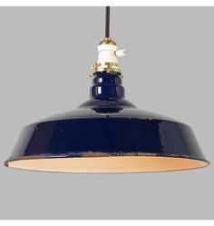 This nice pendant marries a white porcelain turnkey socket with a large 16 porcelain enamel RLM warehouse or shop-type shade in the uncommon cobalt blue color, all hung on classic cloth-covered cord. Shade condition is as-is, with character - i.e., chips in finish, etc. Rejuvenation Lighting & House Parts
