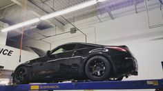 This 350z is in for some @isc_suspension coilovers, @stoptech pads and rotors, @energysuspension bushing kit, wheel bearing and an ajw performance alignment. #nissan #350z #znation #my350z #blackonblack #nismo #brembo #z33 #invidia #ajwperformance #iscsuspension #rwd #lowlife #lowered #static #370z #performanceshop