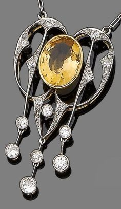 An Art Nouveau topaz and diamond pendant, circa 1905. The openwork cartouche centrally-set with an oval-cut orange topaz, within a surround composed of knife-edge bars highlighted with old brilliant and rose-cut diamonds and terminating in a similarly-set fringe, to a fetter-link chain, Austrian import mark, pendant 4.9cm long. #ArtNouveau #pendant