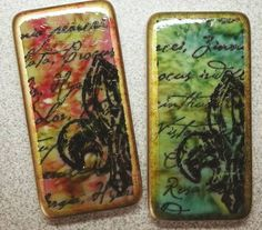 magnets using Tim Holtz Adirondack Alcohol Inks. Left uses pesto & raisin, right uses lettuce and stonewashed. This technique is simple polished stone; the benefit of using alcohol inks on game pieces is the piece needs no prep (no sanding, bleaching, etc.) Unit is edged with a Krylon 18kt gold leafing pen and sealed with Krylon's Triple Thick Crystal Clear Glaze, available at most large craft stores. This layout was inspired from the Too Terrific Tags stamp.