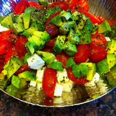 Mozzarella,cherry tomato and avocado salad with sweet basil,black pepper and olive oil dressing:)