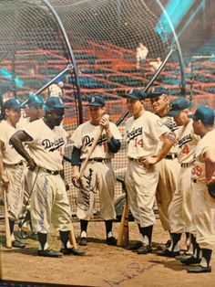 Jackie Robinson and the Brooklyn Dodgers, before they moved to Los Angeles in 1958, L to R, autographed players, Pee Wee Reese, Jackie Robinson # 42, tall man in back is Don Newcombe, # 4 second from right is Duke Snider
