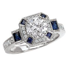 Diamond and Sapphire Engagement ring from the Romance Collection by Kim International. @hobbsjewelers