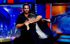 Seth Rollins beating up Jon Stewart