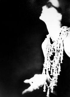 Barbara Mullen aboard Le Bateau Mouche, Chanel Advertising Campaign, Paris, 1960  © Photo by Lillian Bassman
