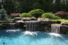 Nature Interior Design And Cool Swimming Pool With Waterfall And Green Garden Also Creative Stone Modern Pool Waterfall Design Ideas-Swiming Pool-Modern Pool Waterfall Design Ideas