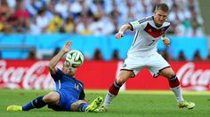 Bastian Schweinsteiger of Germany and Javier Mascherano of Argentina compete for the ball Sunday, 13 July 2014 RIO DE JANEIRO, BRAZIL - JULY 13: Bastian Schweinsteiger of Germany and Javier Mascherano of Argentina compete for the ball during the 2014 FIFA World Cup Brazil Final match between Germany and Argentina at Maracana on July 13, 2014 in Rio de Janeiro, Brazil. (Photo by Alex Livesey - FIFA/FIFA via Getty Images) | www.dribblingman.com