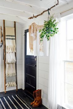 HGTV Shop the Look: Black and White Rustic Chic Entryway >> http://photos.hgtv.com/rooms/viewer/country/front-entry-with-makeshift-mudroom%2c-stick-hanging-station-and-ladder-shelf?soc=pinterest